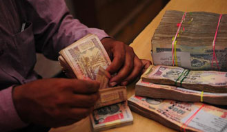 Indian rupee opens lower at 61.88/ dollar